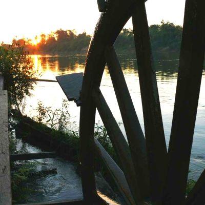 Solnedgång vid Mekongfloden i Laos
