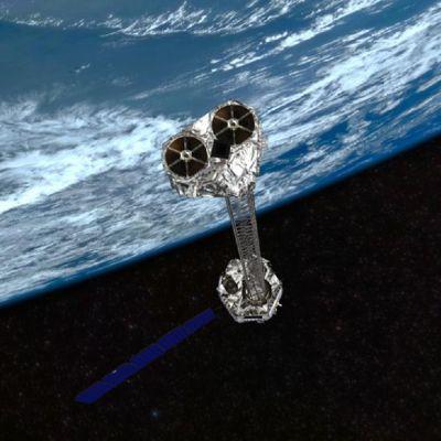 Nustar-satelliitti kiertämässä maata, taiteilijan näkemys.