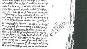 Piirustus kädestä (syyläisestä?) kirjoituksen marginaalissa.