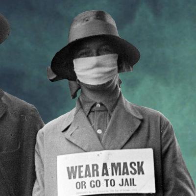 3 personer iförda munskydd under influensapandemin 1918.