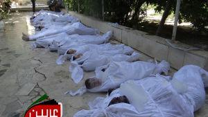 Över tusen människor kan ha dödats i en misstänkt giftgasattack i Damaskus