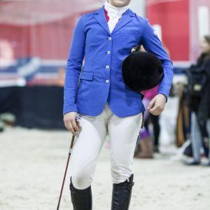 Ratsastaja sinisessä takissaan