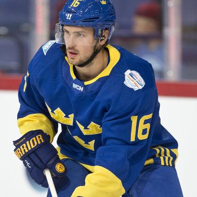 Marcus Krüger i halvbild i hockeyrinken.