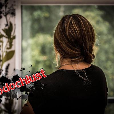 Kvinna i fönstret.