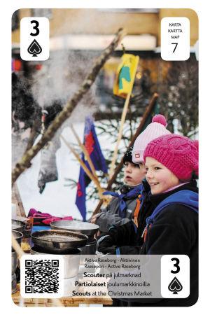En bild på ett kort som föreställer en julmarknad i Raseborg
