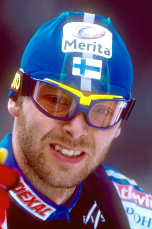 Mika Myllylä, 1999, med logon för Finlands 100 största idrottsögonblick.