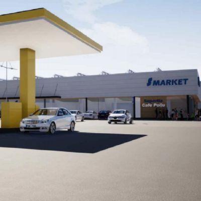 En visualisering av en S-market affär med en bensinmack i förgrunden.
