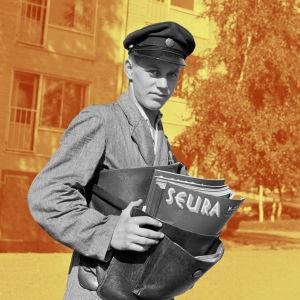Postipoika Martikainen jakaa Seura-lehteä Herttoniemessä.