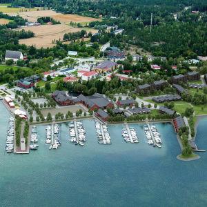 En flybild över Ingå centrum där man ser hur nya bostadshus är inritade i området som kallas Ingåstrand.