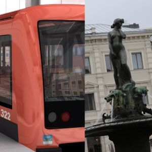 ett rött metrotåg, en staty av en kvinna och ett trätak