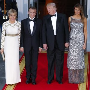 epa06690239  US President Donald J Trump (2-R) and First Lady Melania Trump (R) with French President Emmanuel Macron (2-L) and his wife Brigitte Macron (L) at the North Portico of the White House before a state dinner in the Macrons in Washington, DC, USA, 24 April 2018. President Macron is in DC for three days for a state visit and an address to a joint session of Congress on 25 April. EPA-EFE/ERIK S. LESSER