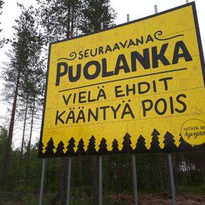 Puolanka tervetuloa kuntaan -kyltti.