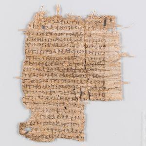 Papyrys, jossa kreikankielistä tekstiä.  Pienessä kuvassa papyrus palasina.
