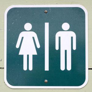 vessan merkki jossa mies ja nainen