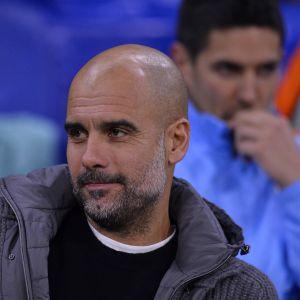 Pep Guardiola lähikuvassa.