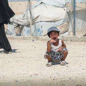 Lapsi al-Holin leirissä Syyriassa