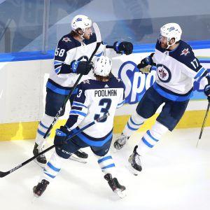 Winnipeg Jetsin Jansen Harkins, Tucker Poolman ja Adam Lowry
