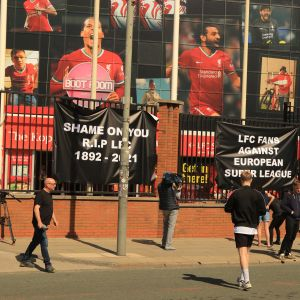 Banners outside Anfield today protesting against Liverpool's owners deciding to join the European Super League. A fan brought his Liverpool shirt and tied it to the grounds railings with the message he wanted the Liverpool owners out. A huge poster a lot higher up summed the fans opinion of the move to the European Super League