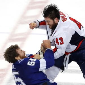 Braydon Coburn #55 of the Tampa Bay Lightning fights with Tom Wilson #43 of the Washington Capitals during the first period in Game Seven of the Eastern Conference Finals during the 2018 NHL Stanley Cup Playoffs at Amalie Arena on May 23, 2018 in Tampa, Florida