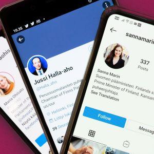Valokuva kolmen puhelimen näytöstä. Ruuduilla on Maria Ohisalon Instagram-tili, Jussi Halla-Ahon Twitter-tili ja Sanna Marinin Instagram-tili.