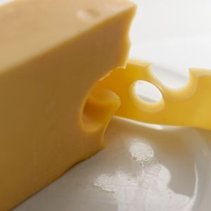 A block and slice of cheese.