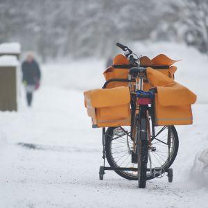 Postinkantajan polkurpyörä