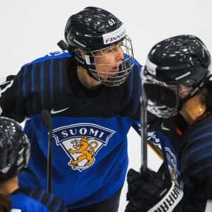 Tanja Niskanen #61 of Finland celebrates with her teammates after scoring against Switzerland in the 2021 IIHF Women's World Championship bronze medal game played at WinSport Arena on August 31, 2021 in Calgary, Canada.