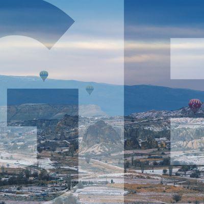 """maisema jossa kuumailmapalloja ja päällä teksti """"GE"""""""