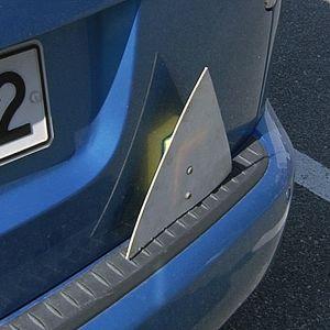 Triangel på bilskolbil