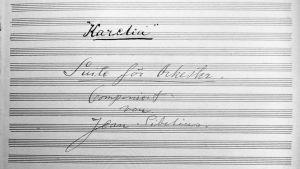 Sibeliuksen Karelia-sarjan nuottilehti säveltäjän allekirjoituksella