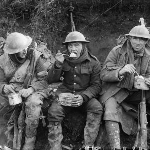 British soldiers eating hot rations in the Ancre Valley during the Battle of the Somme, October 1916