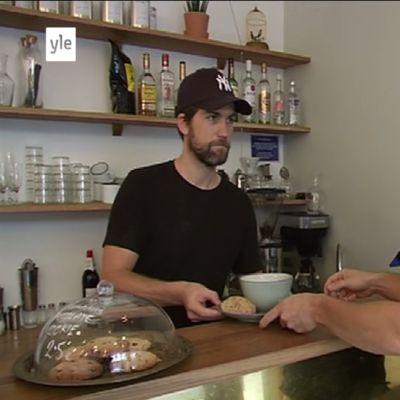 Hello Darling Eatery owner Sam Ashcroft (on left) serves ResQ Club CEO Tuure Parkkinen a bowl of soup.