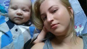 up-kaksoisolentokisavoittaja Pilvi Claudia sekä vauva