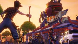 En spelkaraktär i förgrunden stirrar på en förfallen burgarrestaurang i spelet Fortnite.