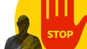 Grafik av person och stop-skylt