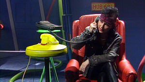 Heli Nevakare juontaa Rockstoppia 1988.