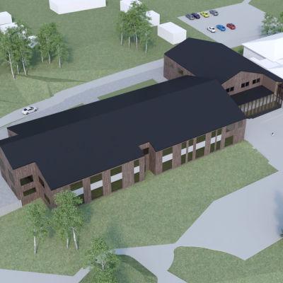 En ritning av en ny byggnad med mörkt tak och brun fasad. Byggnaden har ritats in bredvid en redan befintlig annan byggnad.