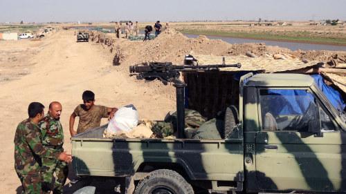 Irakiska sunniter tas upp i armen