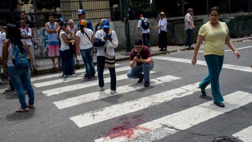 Skott mot demonstranter pojke dog