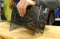 Montera ljusstaken med OH-plasten mellan plexiskivorna