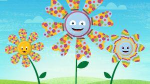 Grafiskt tecknade blommor på en äng