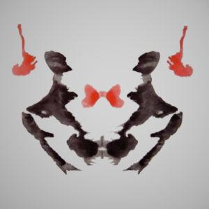 Bläckfläck ur Rorschachtest. Svarta och röda abstrakta figurer.