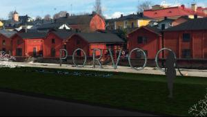 En bild av hur bokstäverna kan se ut. Porvoo bokstäver stående i grått med strandbodarna i bakgrunden.