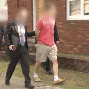 Polisen i Australien gav ut denna bild av den misstänkte agenten då han greps