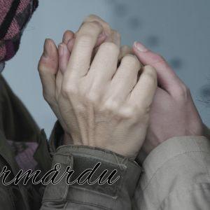 händer som håller i varandra