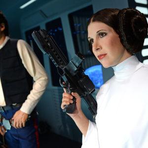 Vaxfigurer av Han Solo och Prinsessan Leia i Berlin i Tyskland.