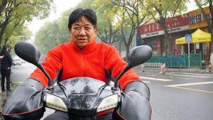 Mopoilijamies Pekingissä.