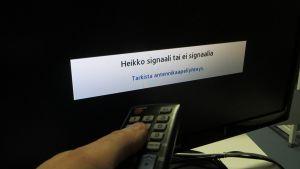Television heikko signaali-teksti ruudussa.