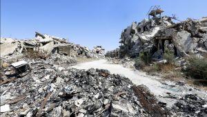 Pommitusten aiheuttamaan tuhoa Syyrian Homsissa.