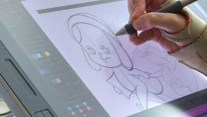 Animaattorin käsi ja animaatiohahmo